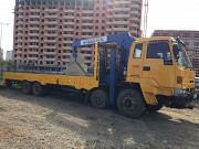 Services rent special equipment low loader tow truck manipulator with a crane and ice Krasnodar